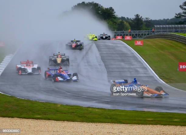 Scott Dixon, Chip Ganassi Racing Honda leads a group of race cars through Turn 5 during the 9th annual Honda Indy Grand Prix of Alabama on April 21...