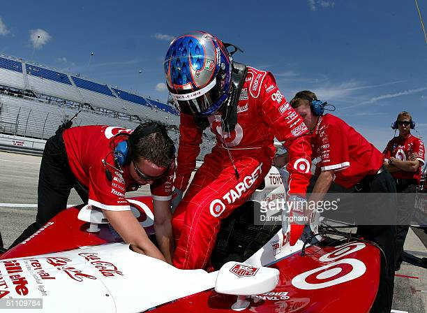 Scott Dixon climbs aboard the Target Chip Ganassi Racing Toyota GForce during practice for the Indy Racing League IndyCar Series Menards AJFoyt Indy...