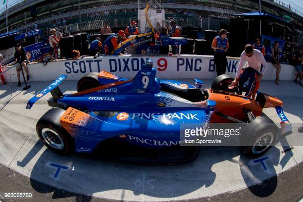 Scott Dixon driver of the Chip Ganassi Racing Honda car sits in the pit box before going to the grid prior to the running of the 102nd Indianapolis...