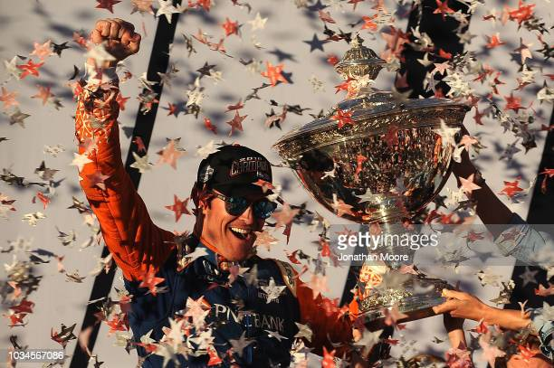 Scott Dixon driver of the Chip Ganassi Racing Honda celebrates in Victory Lane with the Verizon IndyCar Series Championship Trophy after the Verizon...