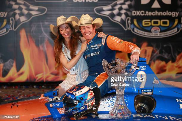 Scott Dixon driver of the PNC Bank Chip Ganassi Racing Honda and his wife Emma Davies Dixon celebrate in Victory Lane after winning the Verizon...