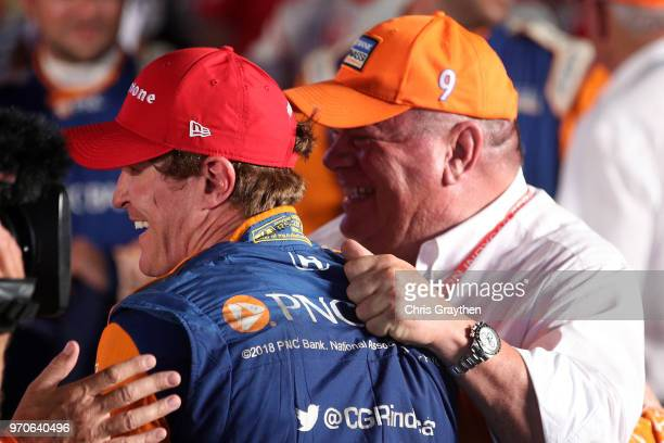 Scott Dixon driver of the PNC Bank Chip Ganassi Racing Honda and team owner Chip Ganassi celebrate in Victory Lane after winning the Verizon IndyCar...