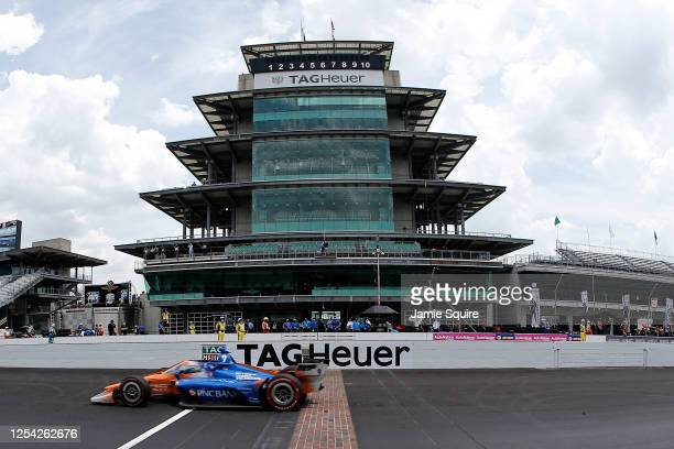 Scott Dixon, driver of the PNC Bank Chip Ganassi Racing Honda, crosses the finish line to win the NTT IndyCar Series GMR Grand Prix at Indianapolis...