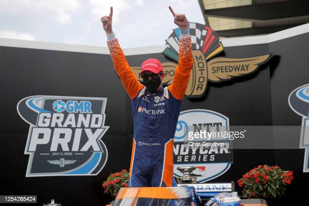 Scott Dixon, driver of the PNC Bank Chip Ganassi Racing Honda, celebrates in Victory Lane after winning the NTT IndyCar Series GMR Grand Prix at...