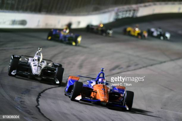 Scott Dixon, driver of the PNC Bank Chip Ganassi Racing Honda, leads a pack of cars during the Verizon IndyCar Series DXC Technology 600 at Texas...