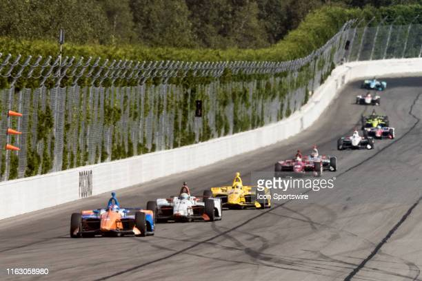 Scott Dixon driver of the PNC Bank Chip Ganassi Racing Honda leads the field down the back stretch after a restart during the ABC Supply 500 on...