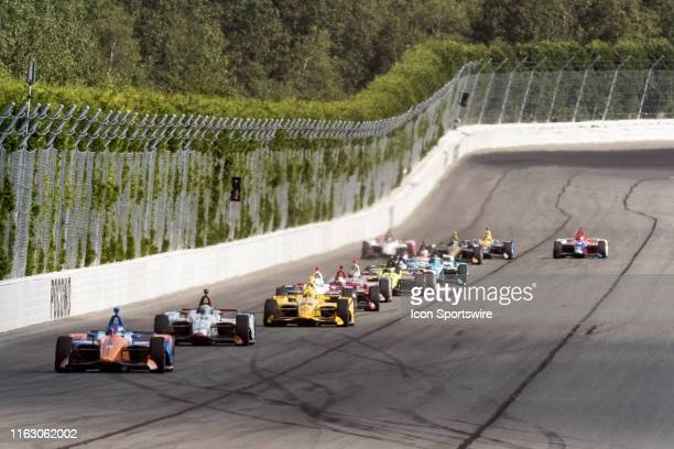 Scott Dixon driver of the PNC Bank Chip Ganassi Racing Honda leads the field down the back stretch on a restart during the ABC Supply 500 on August...
