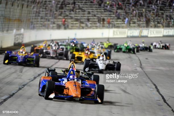 Scott Dixon, driver of the PNC Bank Chip Ganassi Racing Honda, leads the field during the Verizon IndyCar Series DXC Technology 600 at Texas Motor...