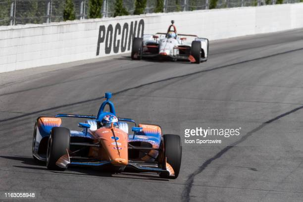Scott Dixon driver of the PNC Bank Chip Ganassi Racing Honda races into turn 2 during the ABC Supply 500 on August 18 at Pocono Raceway in Long Pond...