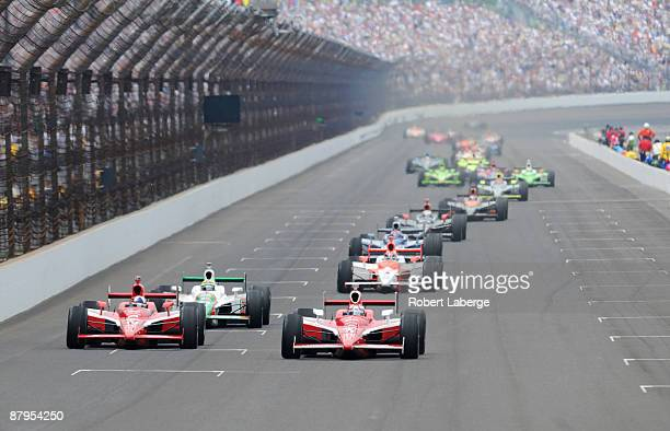 Scott Dixon driver of the Target Chip Ganassi Dallara Honda leads his teammate Dario Franchitti and the rest of the field during the IRL IndyCar...