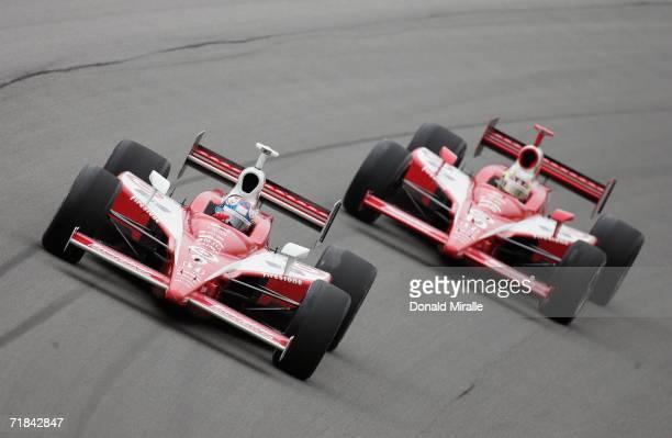 Scott Dixon driver of the Target Chip Ganassi Dallara Honda leads teammate Dan Wheldon driver of the Target Chip Ganassi Dallara Honda during the IRL...