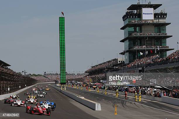 Scott Dixon driver of the Target Chip Ganassi Racing Chevrolet Dallara leads the field at the start of the 99th running of the Indianapolis 500 mile...