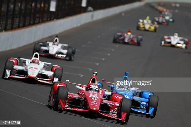 Scott Dixon driver of the Target Chip Ganassi Racing Chevrolet Dallara leads the field during the 99th running of the Indianapolis 500 mile race at...