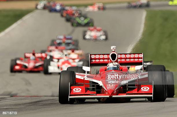 Scott Dixon driver of the Target Chip Ganassi Racing Dallara Honda leads a pack of cars on a restart during the IRL IndyCar Series The Honda Indy 200...