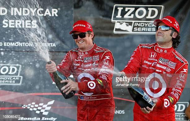 Scott Dixon driver of the Target Chip Ganassi Racing Dallara Honda sprays champagne with teammate Dario Franchitti after winning the Indy Car Series...