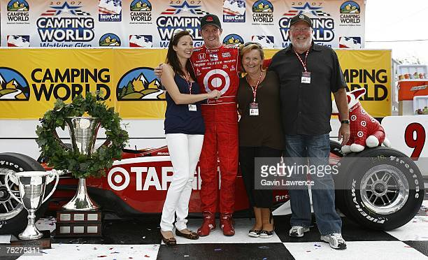 Scott Dixon driver of the Target Chip Ganassi Racing Dallara Honda poses with fiancee Emma Davies and mother Glynis and father Ron during the Indy...