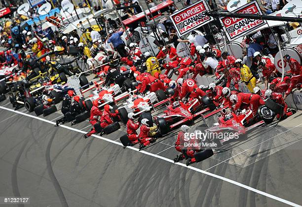 Scott Dixon driver of the Target Chip Ganassi Racing Dallara Honda sits in front of the field as they make the first pit stop during the IRL IndyCar...