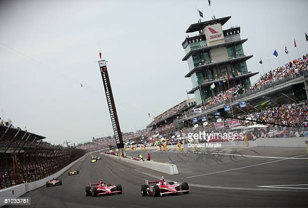 Scott Dixon driver of the Target Chip Ganassi Racing Dallara Honda leads the pack with teammate Dan Wheldon driver of the Target Chip Ganassi Racing...