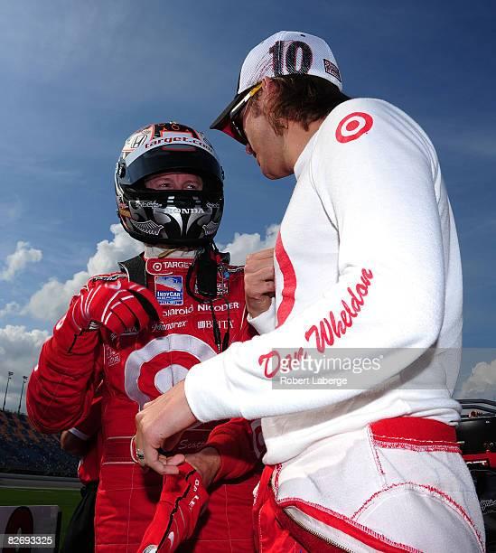 Scott Dixon driver of the Target Chip Ganassi Racing Dallara Honda chats with his teammate Dan Wheldon before qualifying for the IndyCar Series Peak...