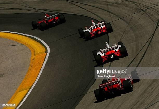 Scott Dixon driver of the Target Chip Ganassi Racing Dallara Honda chases down Ryan Briscoe in the Team Penske Dallara Honda his team mate Helio...