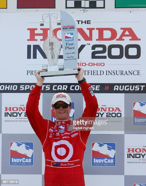 Scott Dixon driver of the Target Chip Ganassi Racing Dallara Honda celebrates winning the IRL IndyCar Series The Honda Indy 200 on August 9 2009 at...