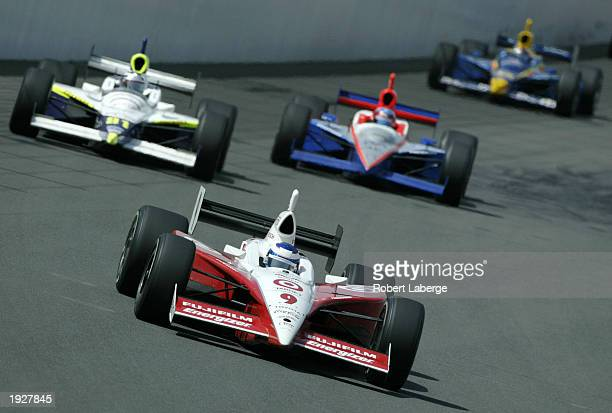 Scott Dixon, driver of the Target Chip Ganassi Racing Toyota Panoz G Force leads a pack of cars during the Indy Japan 300, round three of the IRL...
