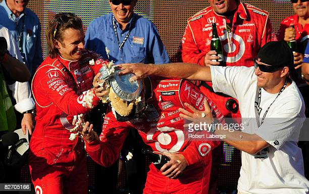 Scott Dixon driver the Target Chip Ganassi Racing Dallara Honda gets a pie in the face from his teammate Dan Wheldon and a friend after winning the...