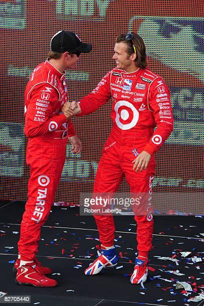 Scott Dixon driver the Target Chip Ganassi Racing Dallara Honda is congratulated by his teammate Dan Wheldon after winning the IndyCar driver's...