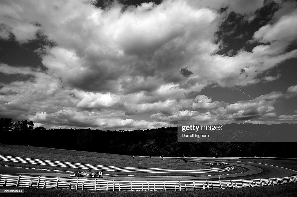 Scott Dixon drives the #9 Target Chip Ganassi Racing Dallara Honda under the clouds during practice for the IRL IndyCar Series Camping World Grand Prix at The Glen on July 4, 2009 at the Watkins Glen International in Watkins Glen, New York, United States.