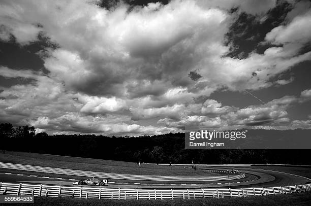 Scott Dixon drives the Target Chip Ganassi Racing Dallara Honda under the clouds during practice for the IRL IndyCar Series Camping World Grand Prix...
