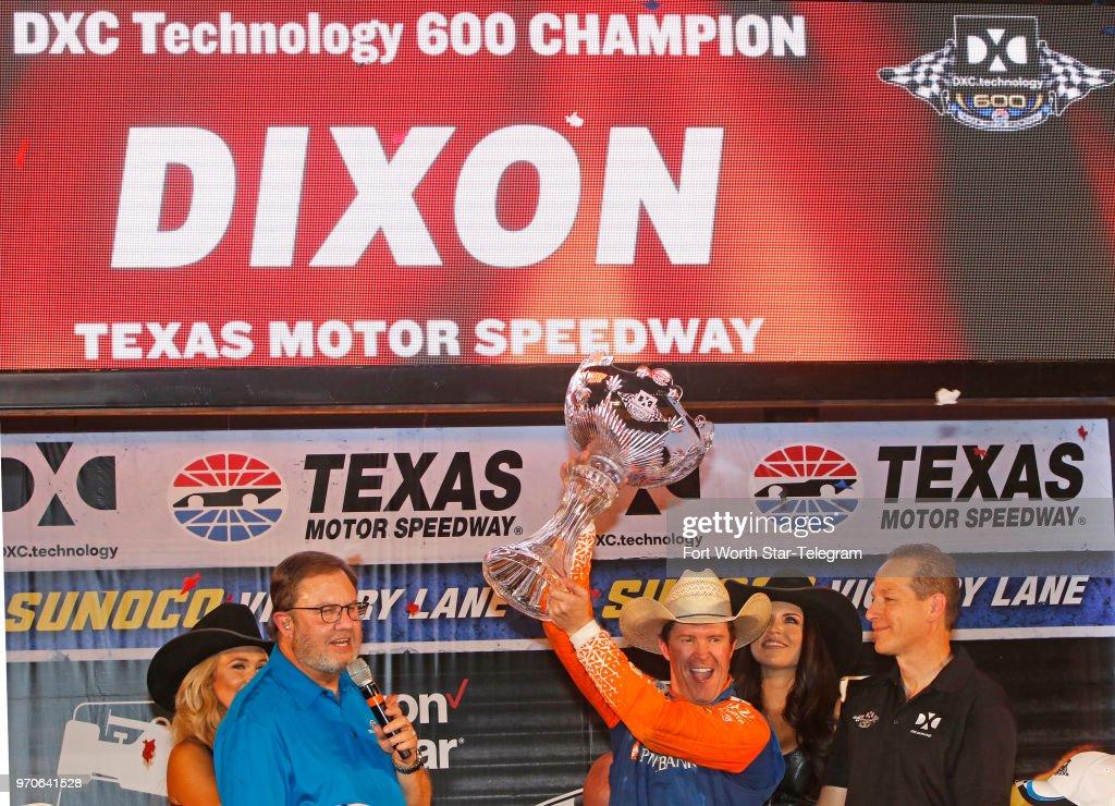 Scott Dixon hoists the trophy after winning the DXC