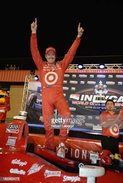 Scott Dixon of New Zealand and driver of the Target Chip Ganassi Racing Dallara Honda celebrates winning the IZOD IndyCar Series Championship during...