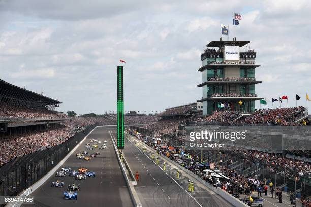 Scott Dixon of New Zealand driver of the Camping World Honda leads the field during the 101st Indianapolis 500 at Indianapolis Motorspeedway on May...