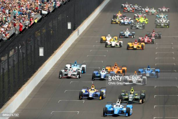 Scott Dixon of New Zealand, driver of the Camping World Honda, leads the field during during the 101st Indianapolis 500 at Indianapolis Motorspeedway...
