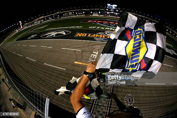 Scott Dixon of New Zealand driver of the Energizer Chevrolet crosses the finish line to win the Verizon IndyCar Series Firestone 600 at Texas Motor...