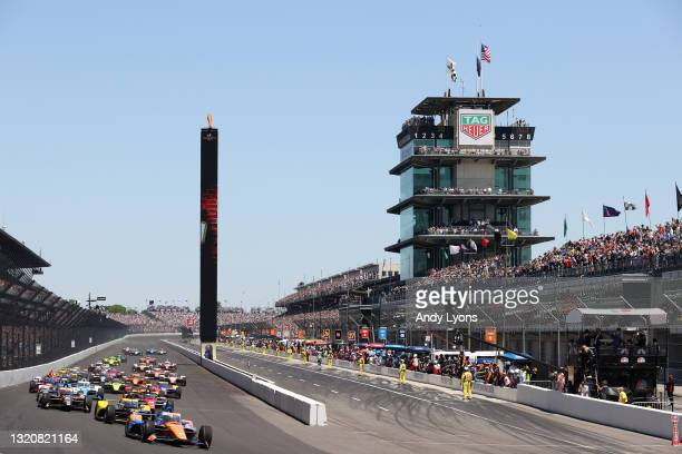 Scott Dixon of New Zealand, driver of the PNC Bank Chip Ganassi Racing Honda, leads the field at the start of the 105th Running Of The NTT IndyCar...