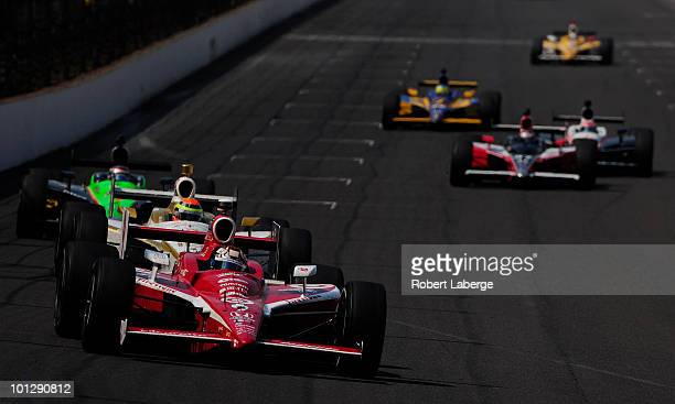 Scott Dixon of New Zealand driver of the Target Chip Ganassi Racing Dallara Honda leads a pack of cars during the IZOD IndyCar Series 94th running of...