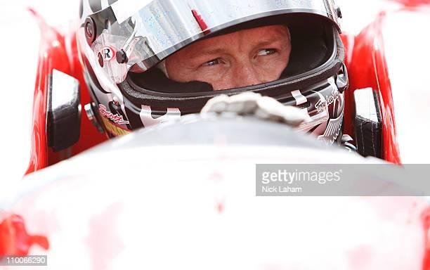 Scott Dixon of New Zealand, driver of the Target Chip Ganassi Racing Dallara Honda sits in his car during IZOD IndyCar Series Spring Training at...
