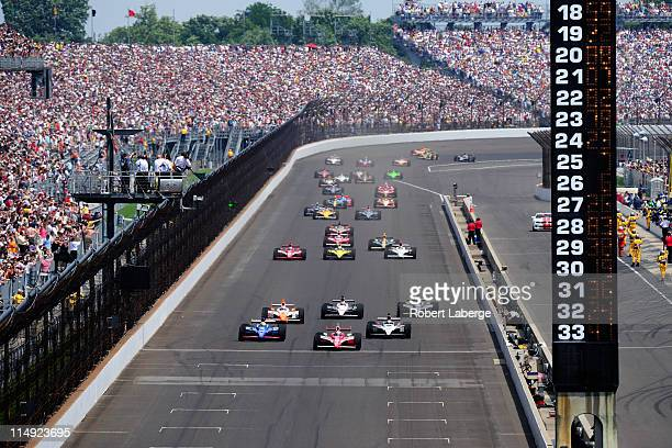 Scott Dixon of New Zealand driver of the Target Chip Ganassi Racing Dallara Honda leads the field at the start of the IZOD IndyCar Series...