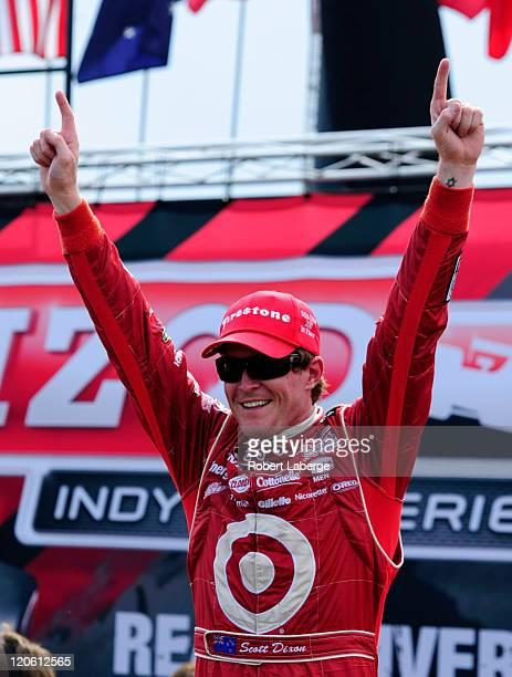 Scott Dixon of New Zealand driver of the Target Chip Ganassi Racing Dallara Honda celebrates after winning the IZOD IndyCar Series Honda Indy 200 at...