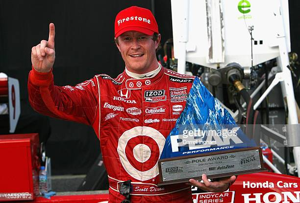 Scott Dixon of New Zealand driver of the Target Chip Ganassi Racing Dallara Honda celebrates pole position for the Indy Japan 300 The Final on the...