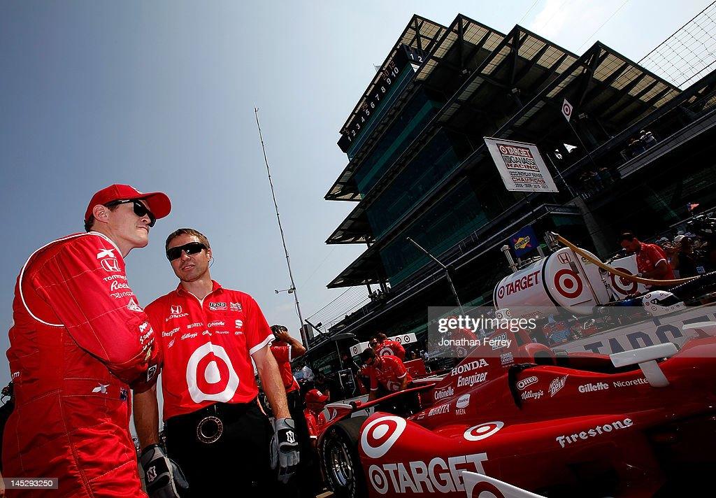 Scott Dixon of New Zealand, driver of the #9 Target Chip Ganassi Racing Honda Dallara DW12 talks to crew during practice for the the 96th Indianapolis 500 Mile Race at the Indianapolis Motor Speedway on May 25, 2012 in Indianapolis, Indiana.