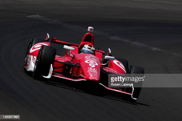 Scott Dixon of New Zealand driver of the Target Chip Ganassi Racing Honda races during the IZOD IndyCar Series 96th running of the Indianapolis 500...