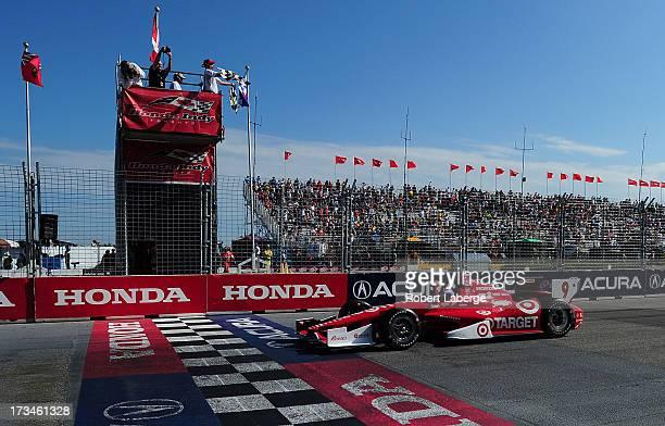 Scott Dixon of New Zealand driver of the Target Chip Ganassi Racing Honda Dallara crosses the finish line to win race of the IZOD IndyCar Series...