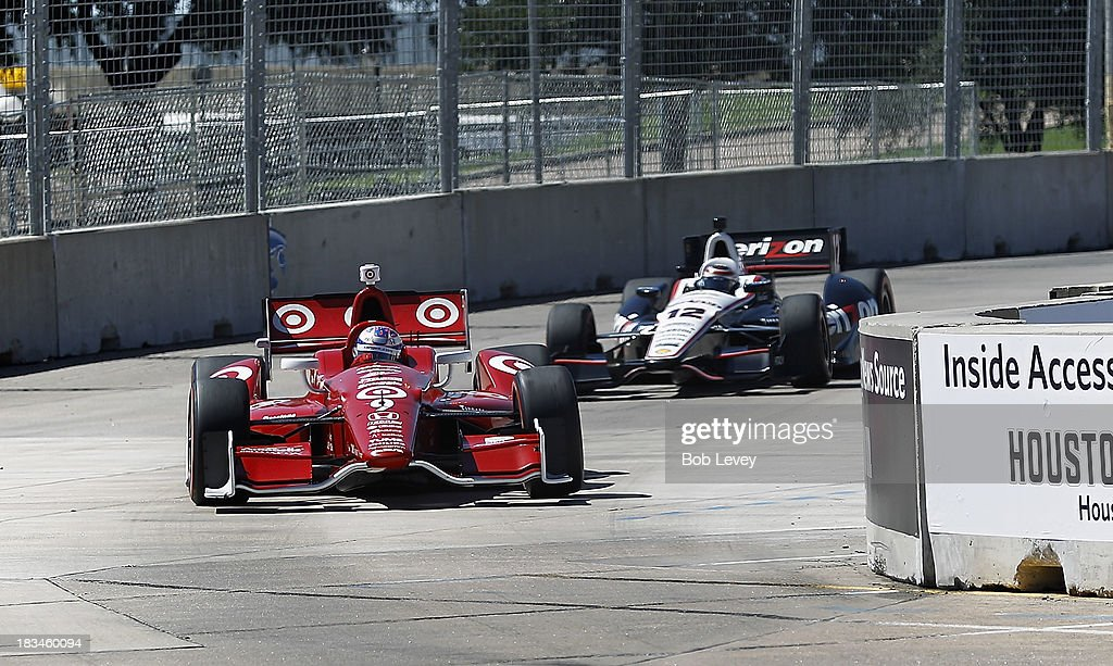 Scott Dixon of New Zealand, driver of the #9 Target Chip Ganassi Racing Honda Dallara, leads Will Power, driver of the #12 Team Penske car coming out of turn number 10 during the Shell And Pennzoil Grand Prix Of Houston Race #2 at Reliant Park on October 6, 2013 in Houston, Texas.