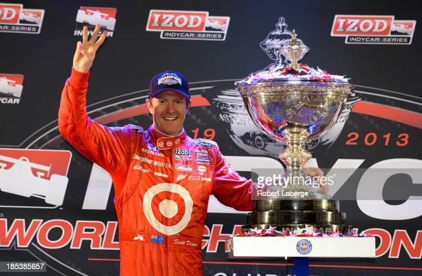Scott Dixon of New Zealand driver of the Target Chip Ganassi Racing Dallara Honda poses with the Astor Cup after winning the IZOD IndyCar Series...