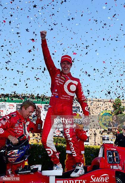 Scott Dixon of New Zealand driver of the Target Chip Ganassi Racing Chevrolet Dallara celebrates winning the IndyCar Championship for the Verizon...