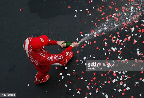 Scott Dixon of New Zealand, driver of the Target Chip Ganassi Racing Dallara Chevrolet, celebrates taking third place in the Honda Indy Car Grand...