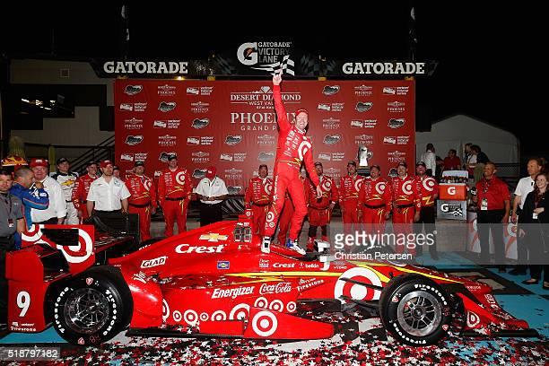 Scott Dixon of New Zealand driver of the Target Chip Ganassi Racing Chevrolet IndyCar celebrates after winning the Phoenix Grand Prix at Phoenix...