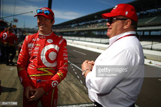 Scott Dixon of New Zealand, driver of the Target Chip Ganassi Racing Chevrolet, talks with team owner Chip Ganassi as he prepares to drive on Carb...